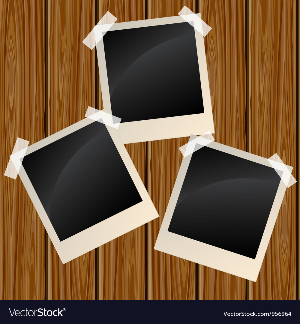 Blank photos on a wooden wall vector