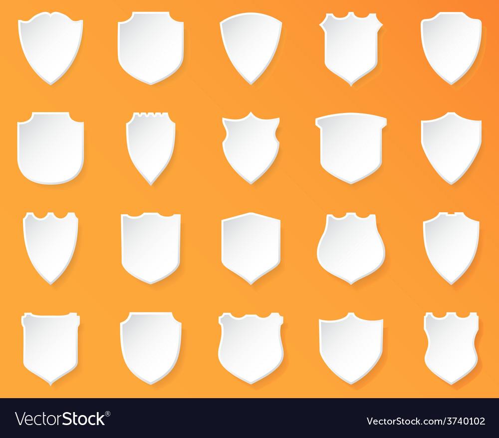 Shiny white shields on a orange background vector