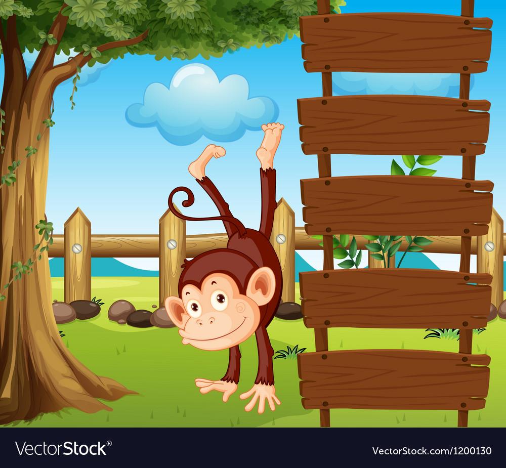 An ape beside the empty wooden signboards vector