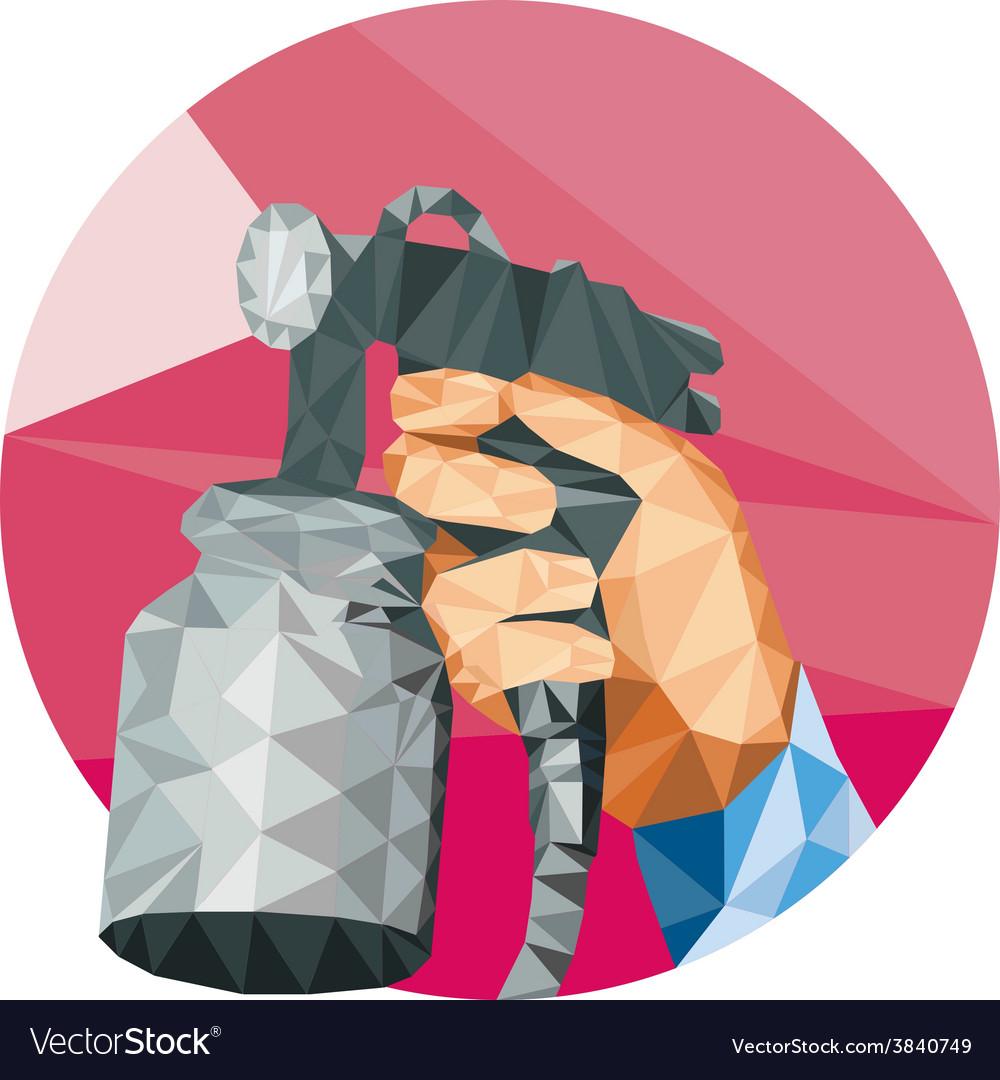 Hand spray paint gun spraying low polygon vector