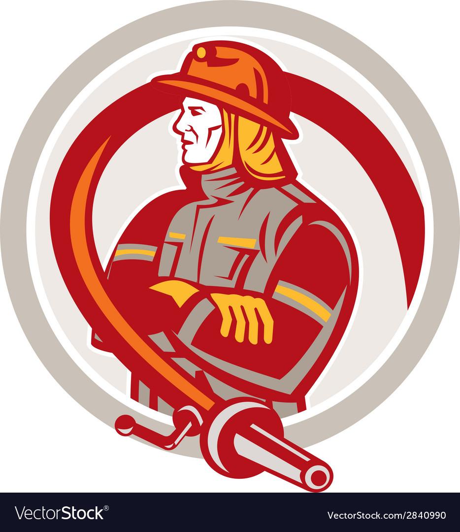 Fireman firefighter standing folding arms circle vector