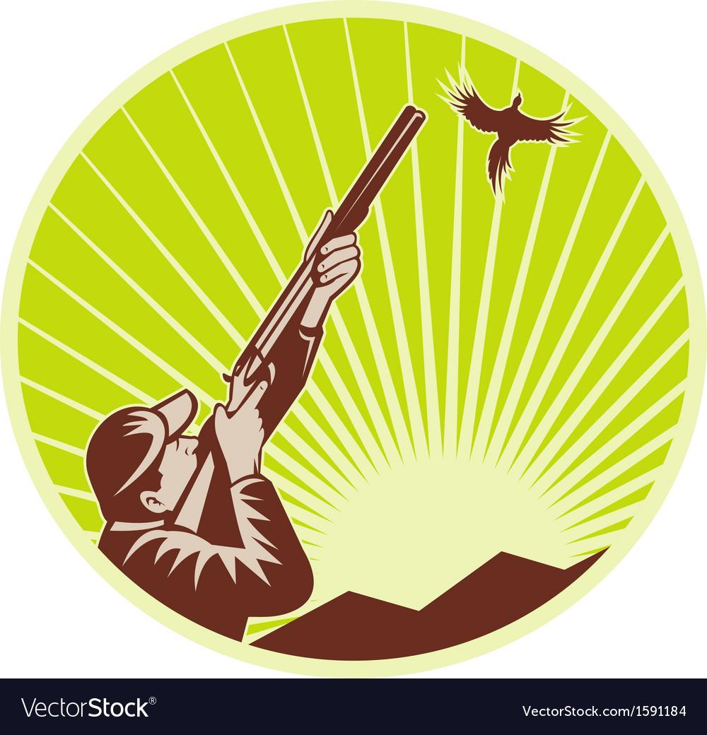 Hunter with shotgun rifle aimng at pheasant vector