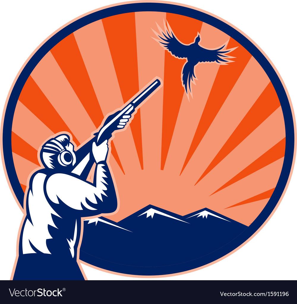 Hunter aiming shotgun rifle at bird pheasant vector