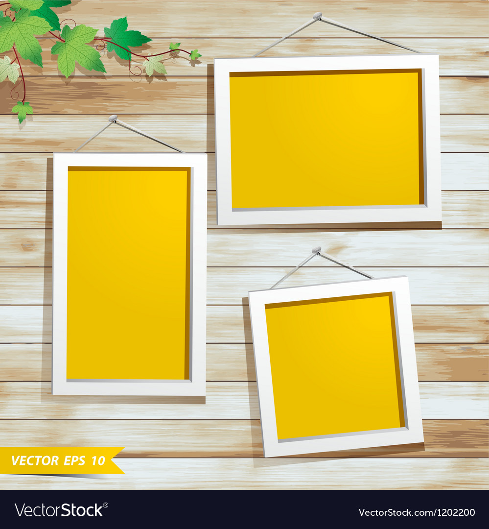 White photo frame on wood background vector