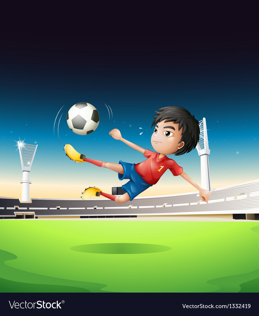 A boy in a red uniform at the soccer field vector