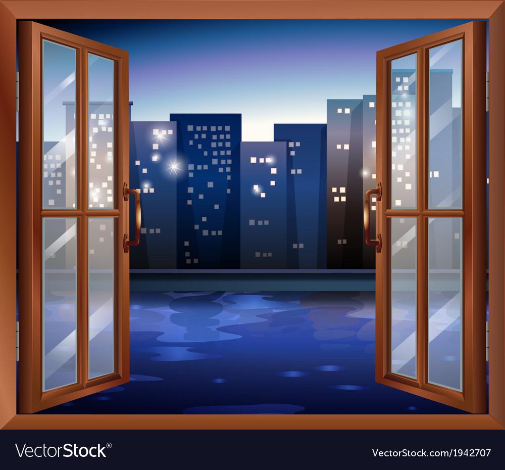 A window across the tall city buildings vector