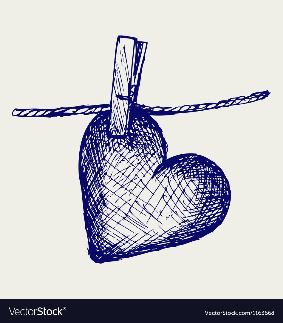 Heart in clothesline vector
