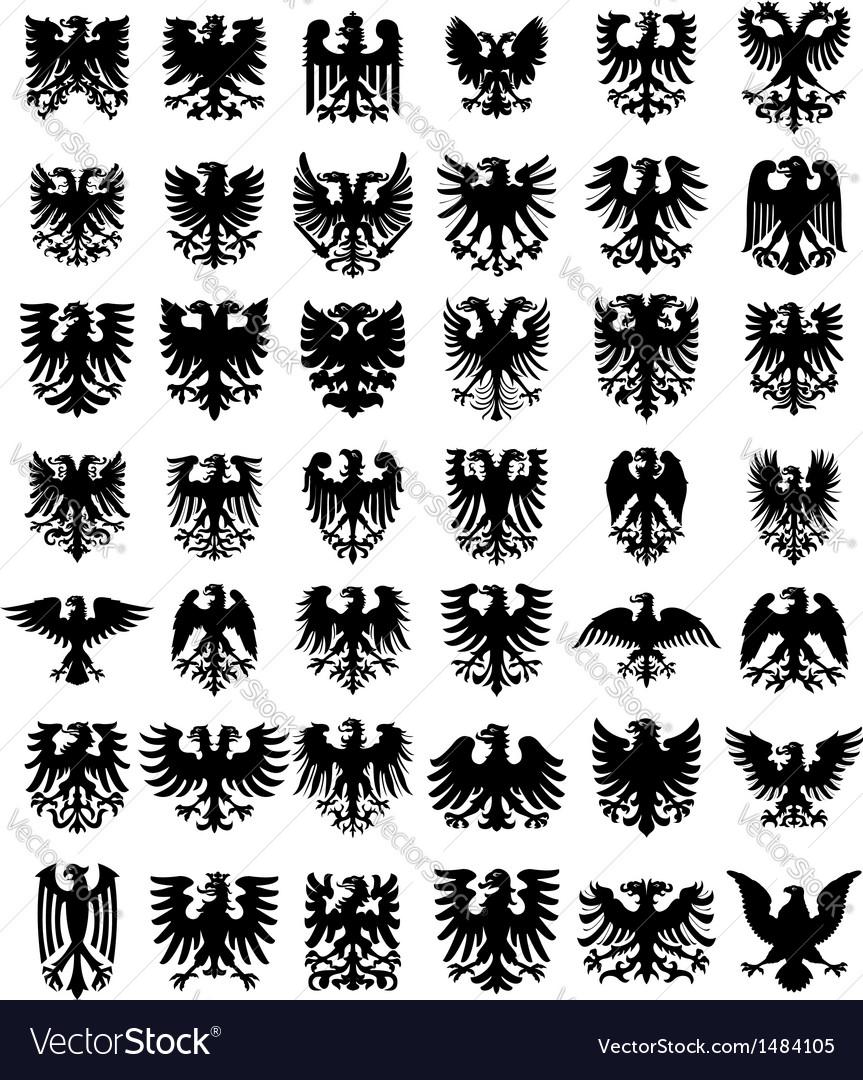 Heraldic eagles silhouettes set vector