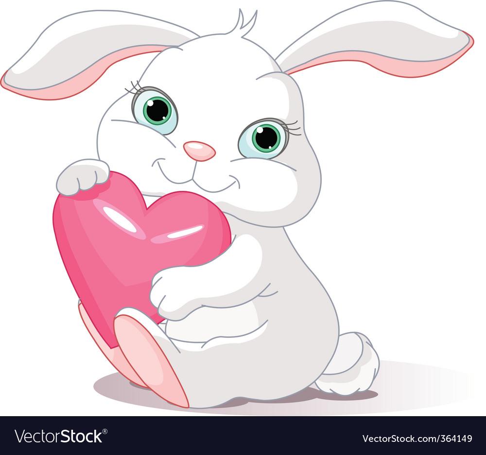 Rabbit holds love heart vector