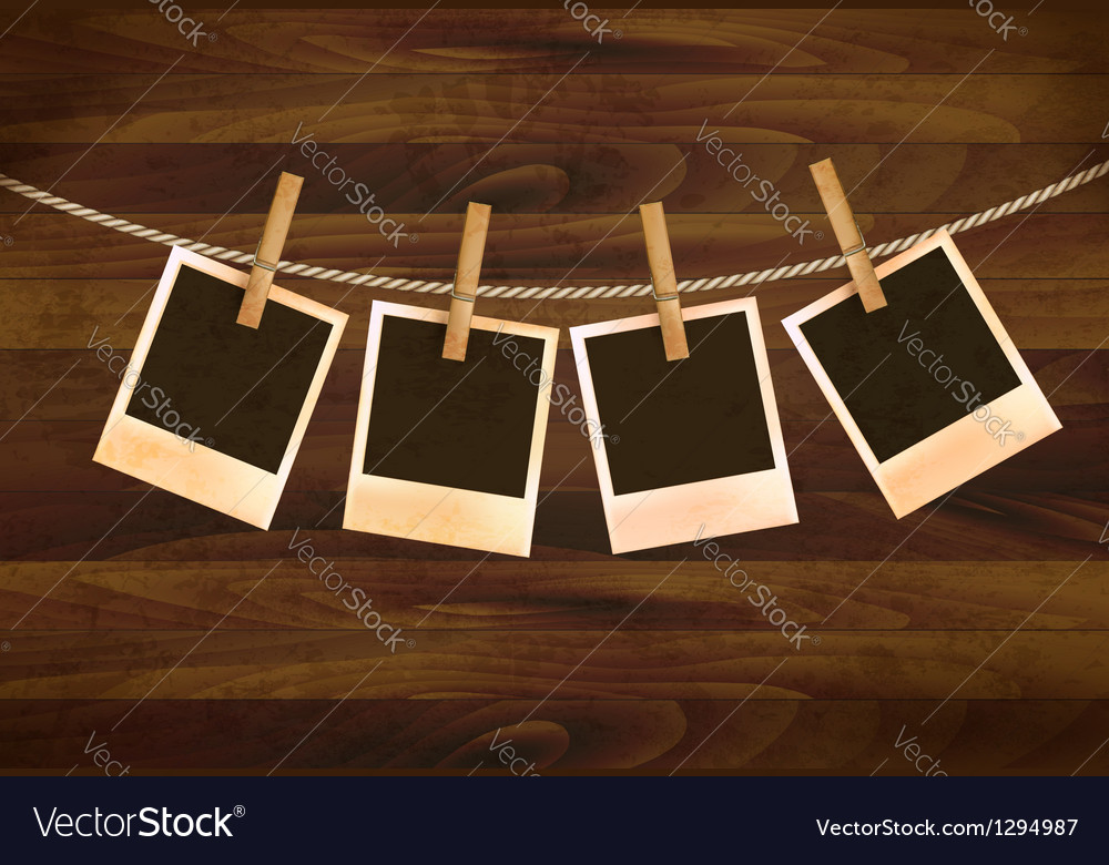 Retro photos hanging on a rope on dark wooden vector