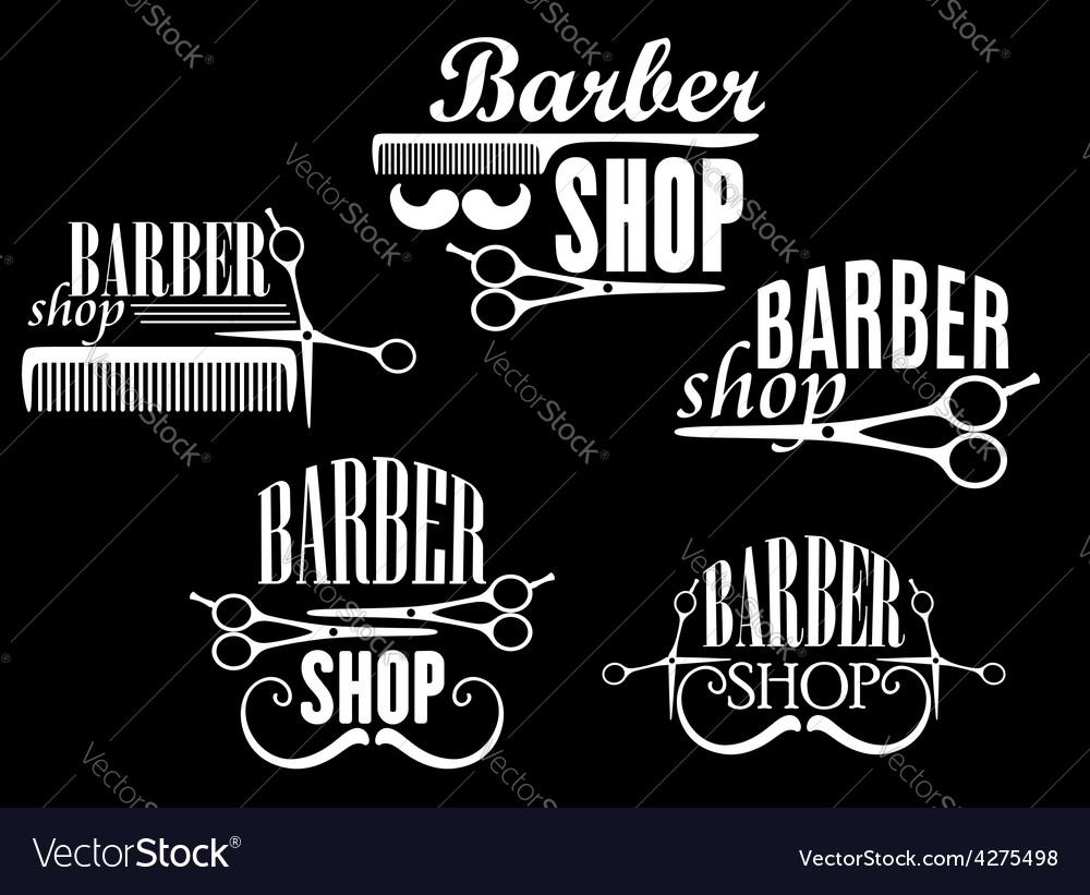 Vintage barber shop emblems on black background vector