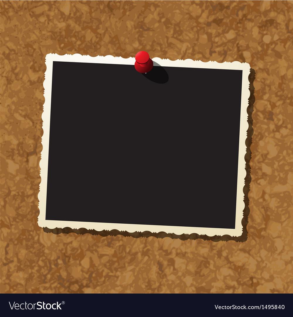 Photo frame on cork board vector