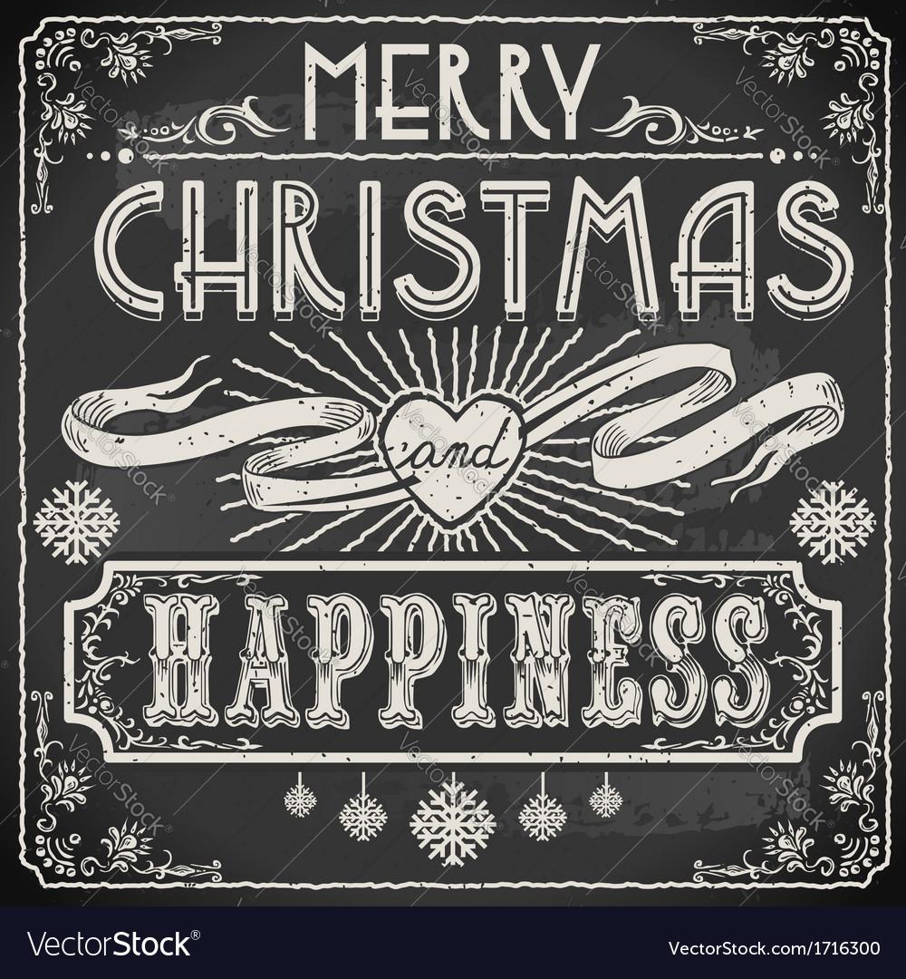 Vintage merry christmas text on a blackboard vector