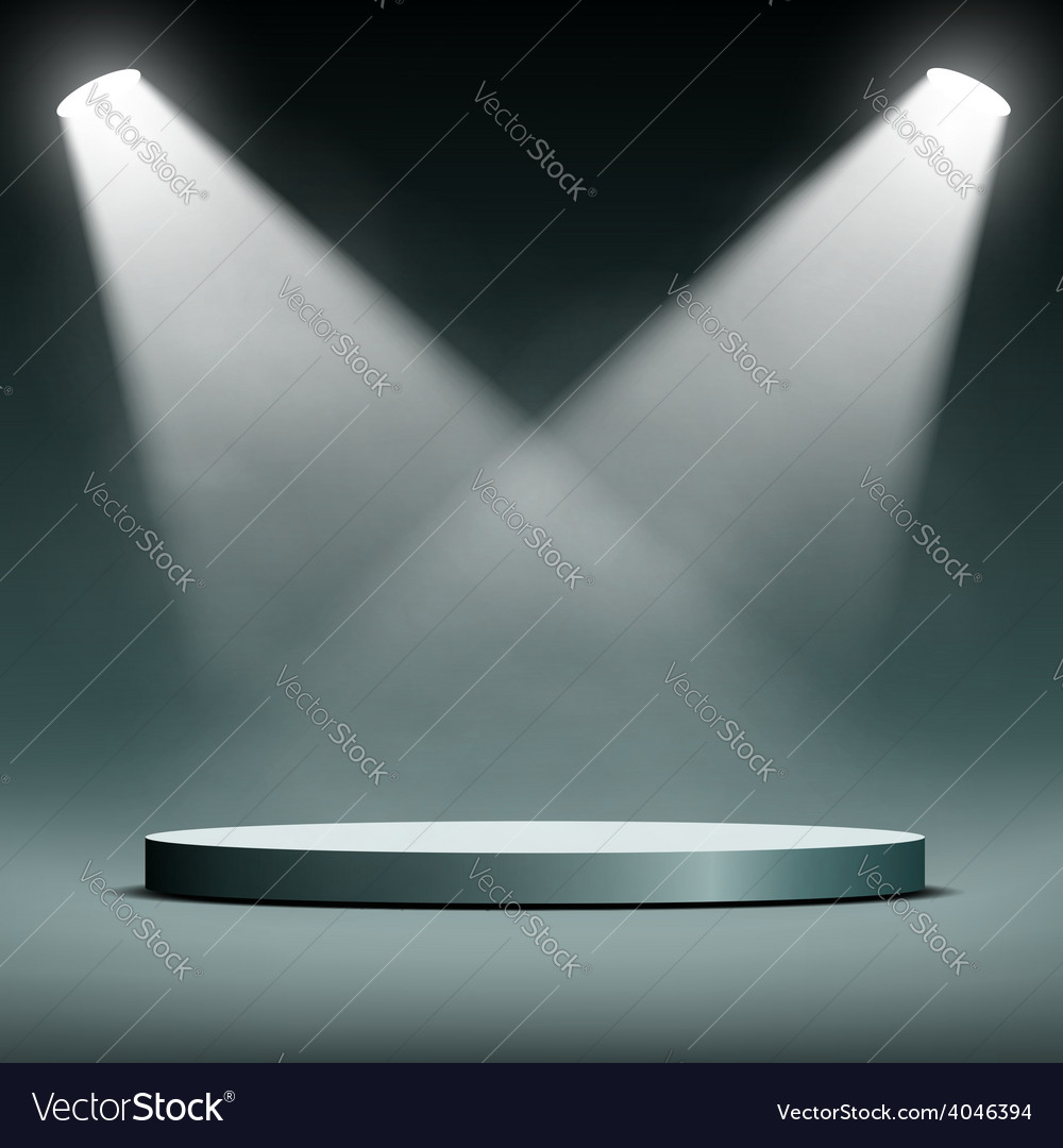 Two spotlights illuminate the podium for the vector