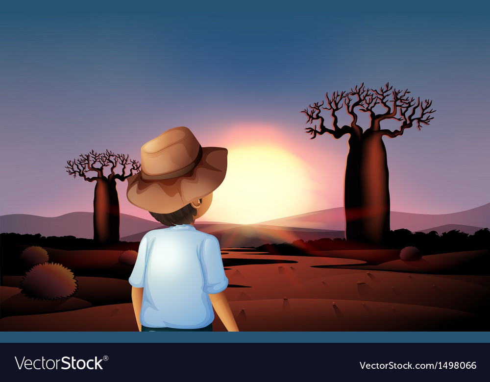 A boy with a hat watching the sunset in the desert vector