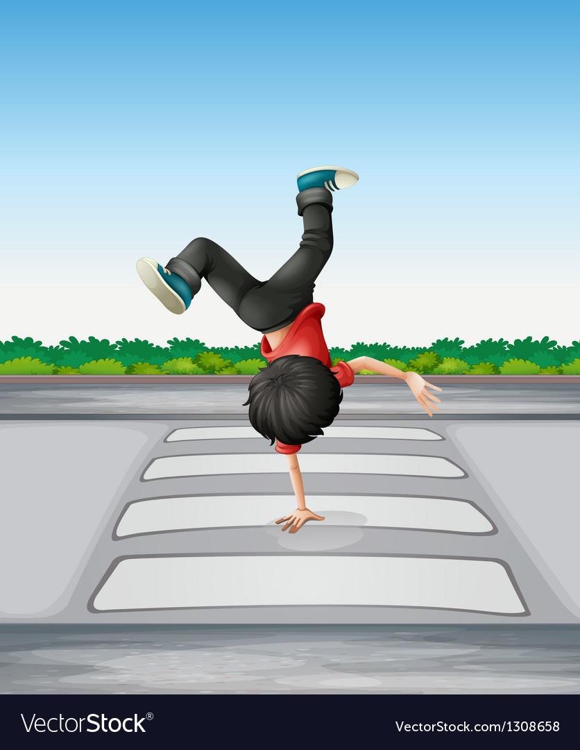 A boy breakdancing at the pedestrian lane vector