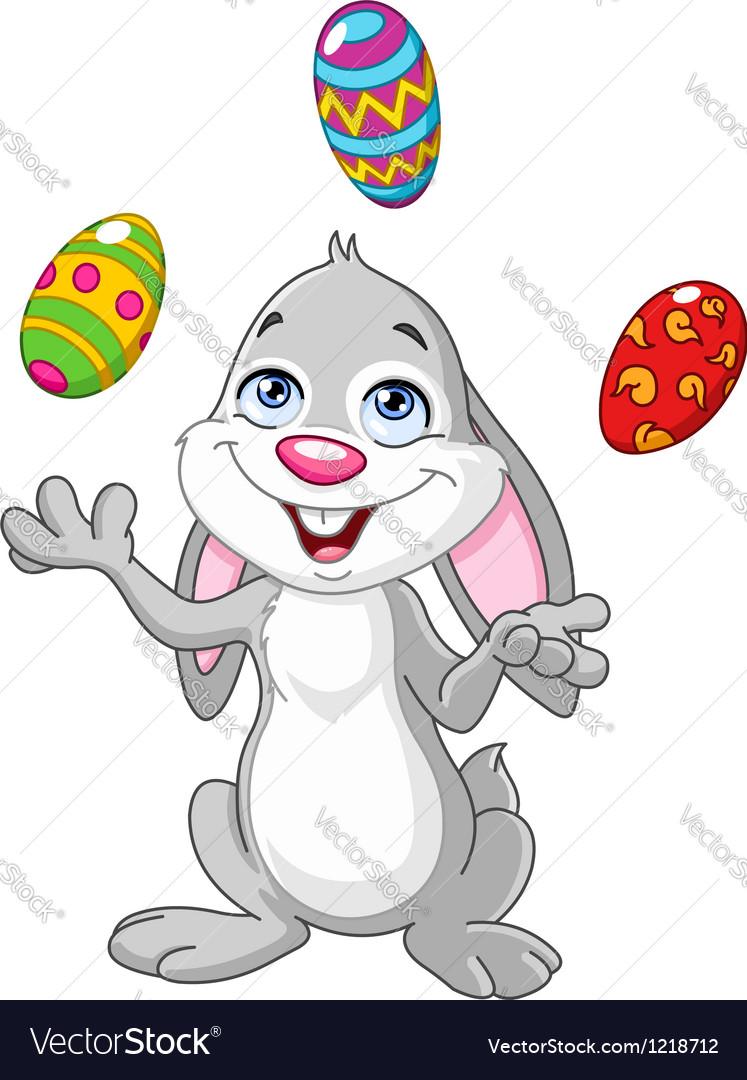 Bunny juggling easter eggs vector