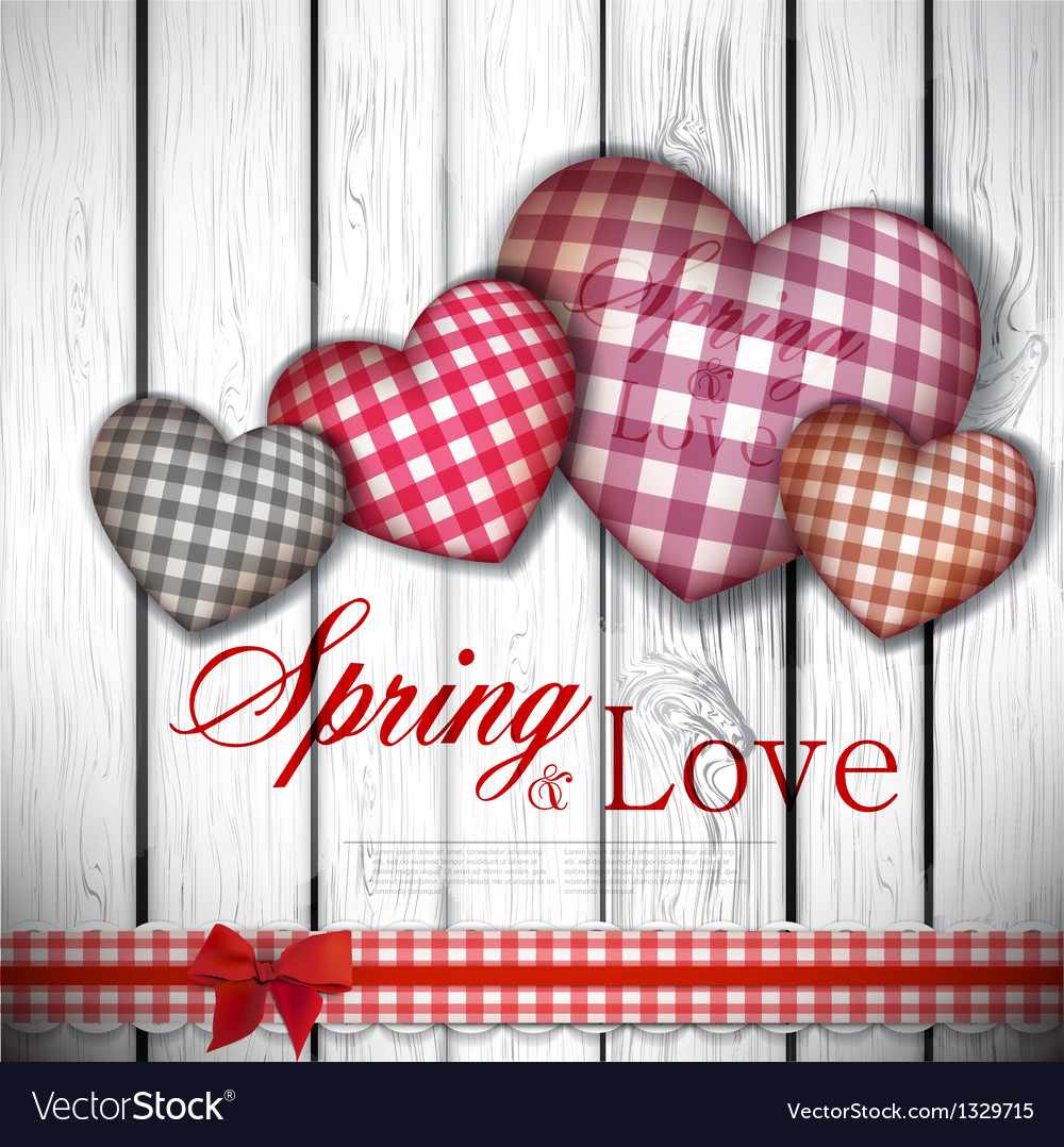 Red cloth handmade hearts on wooden background vector