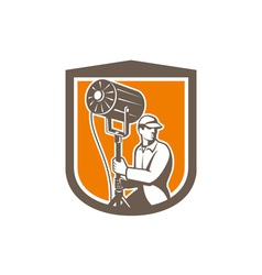 Electrical lighting technician with spotlight vector