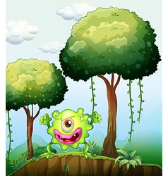 A playful green monster at the cliff in the forest vector