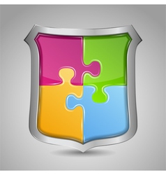 Shield with puzzle pieces vector