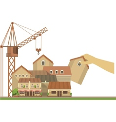 Hand puts house on the city project vector