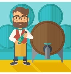 Wine maker inspecting wine from barrel vector