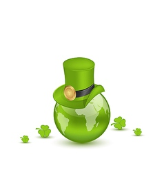 Hat and shamrocks around globe on st patricks day vector