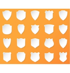 Shiny white shields on a orange background vector