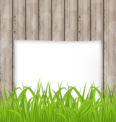 Green grass and paper sheet on wooden texture vector