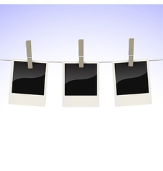 Photos on clothesline vector