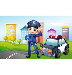 A policeman with a police car along the street vector