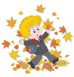 Schoolboy with autumn leaves vector
