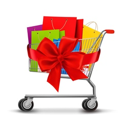Shopping cart full of shopping bags and a gift bow vector