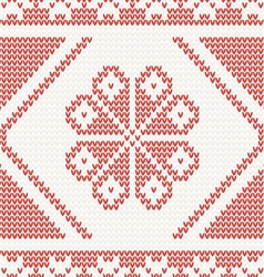 Seamless knitted pattern with red flower vector