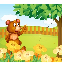 A bear inside the fence pointing a bee vector