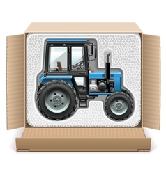 Toy tractor in box vector