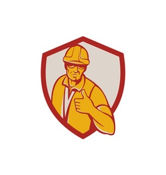 Construction worker thumbs up shield retro vector