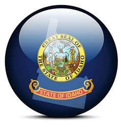 Map on flag button of usa idaho state vector