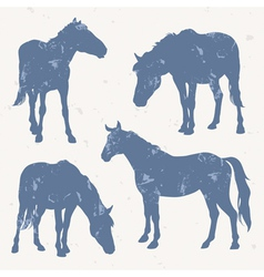Horse silhouettes with grunge effect vector