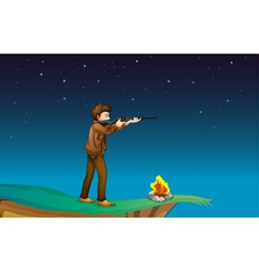 A boy with a gun at the cliff with a campfire vector