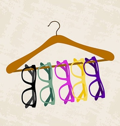 Hipster glasses on a hanger for clothes vector