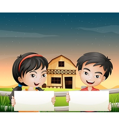 Two adorable kids with empty cardboards vector