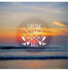 White surfing camp logo on blurred ocean sunset vector