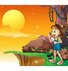 A young girl near the cliff holding a small shovel vector