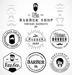 Vintage barber shop badges and labels vector