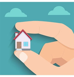Tiny house in hand vector