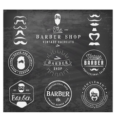 Vintage barber shop badges and labels on chalkboar vector