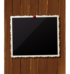 Vintage photo frame on wood vector