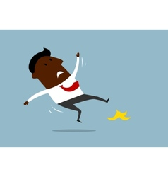 African american businessman slipping on a banana vector